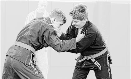Two youths practicing MMA moves